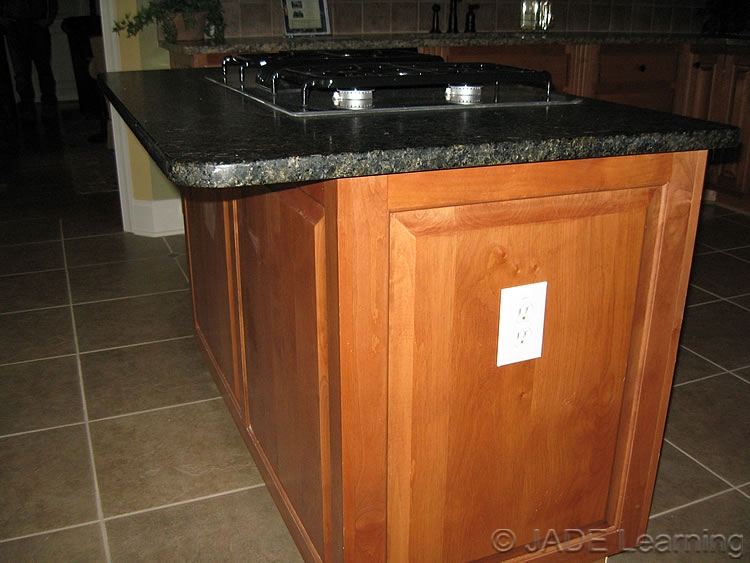 Countertop Receptacle : ... outlets shall be mounted not more than 12 in. below the countertop